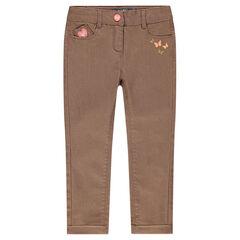 Pantalón corte slim de sarga engrasada con estampado