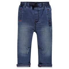 Jeans efecto usado cintura elástica con bolsillos