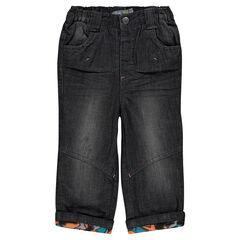 Jeans efecto usado con forro de tejido de punto con estampado
