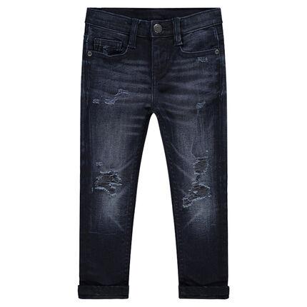 Jeans effet used et crinkle avec déchirures fantaisie