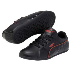 Zapatillas de deporte Puma de color negro con ribete de color rojo