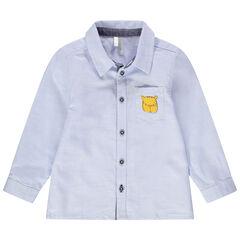 Camisa de manga larga azul con bolsillo estampado de tigre