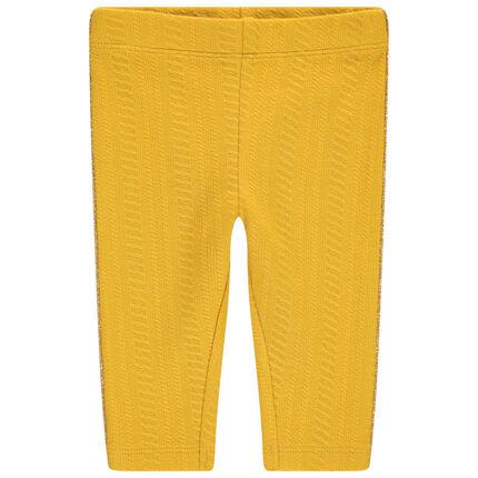 Leggings con trenzas amarillas y cenefa dorada