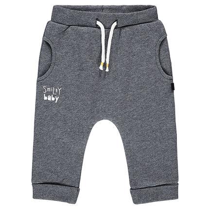 Pantalon de jogging en molleton gris chiné avec print ©Smiley au dos