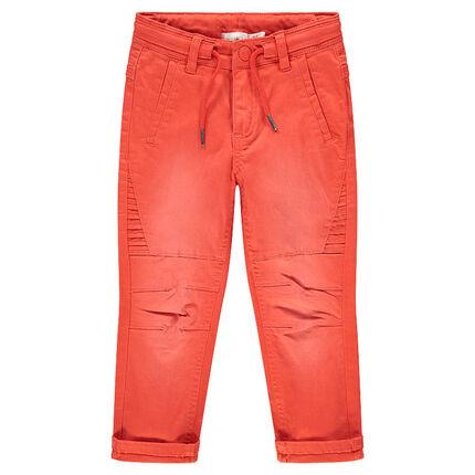 Pantalón de algodón teñido de naranja con efecto desgastado