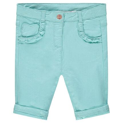 Pantalón de algodón azul con bolsillos con volantes