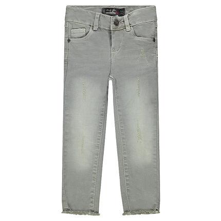 Jeans efecto usado con fantasía con flecos